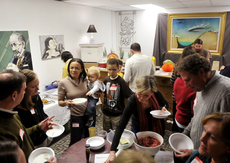 Guests enjoy sampling appetizers during the all vegan Gentle Thanksgiving Dinner held recently at the Urban Farm Fermentory in Portland. The annual potluck event is hosted by the Maine Vegan Meet Up group and this year attracted more than 40 guests.