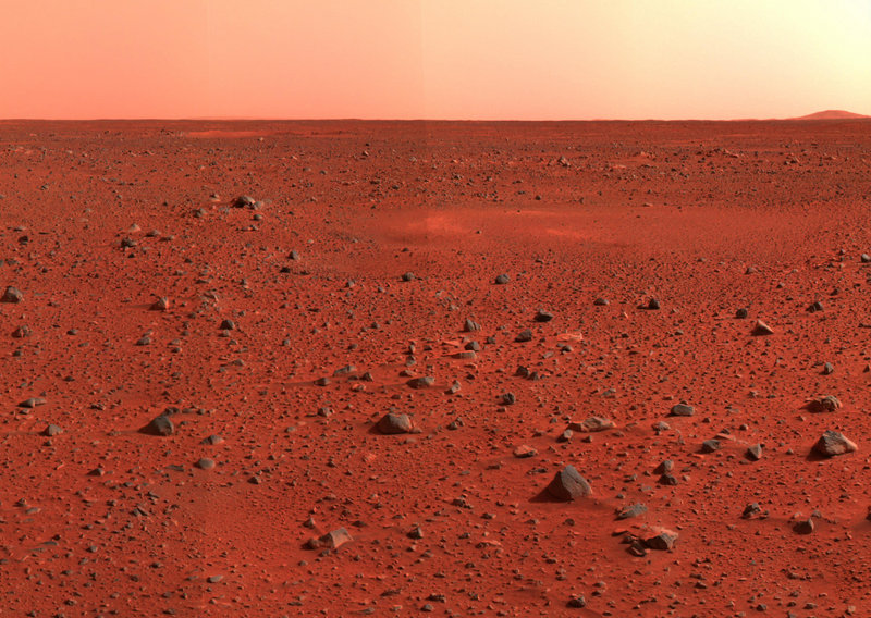 Mosaic image taken by the Mars Exploration Rover Spirit's panoramic camera shows a view of Mars southwest of the rover's landing site in the Gusev Crater. Two scientists propose sending volunteers to Mars and leaving them there. They say the mission would mark the beginning of long-term human colonization of Mars.