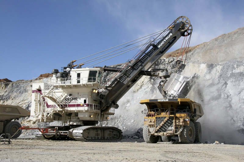 A Bucyrus International 495HR electric mining shovel loads a Cat 793C mining truck at a mine site. Caterpillar Inc., the world s largest construction and mining equipment maker, said Monday, Nov. 15, 2010, it has agreed to buy Bucyrus International Inc. for $7.6 billion in cash.