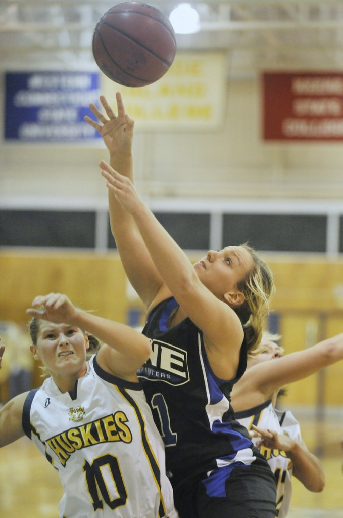 Liz LeBlanc drives to the basket against USM's Nicole Garland. LeBlanc made four of UNE's 10 3-pointers and finished with 13 points.