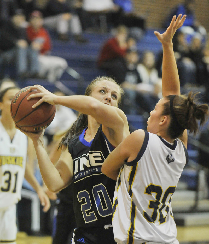 Margo Russell of UNE looks for room to shoot against USM's Kaylie DeMillo during a women s basketball season opener Monday in Gorham. Russell scored 12 points to help the Nor'easters earn an 89-79 victory.