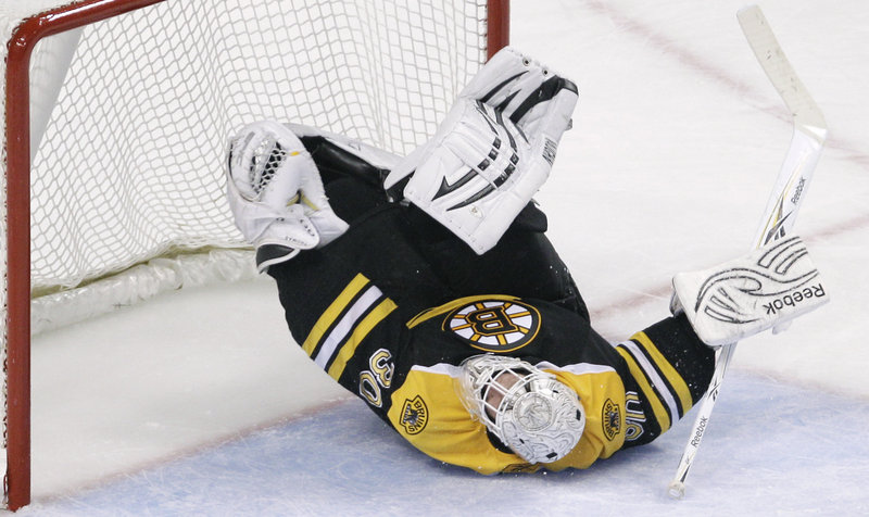 Tim Thomas makes one of his 28 saves during Boston's 3-0 win over the New Jersey Devils on Monday. Thomas, who improved to 9-1, said it was important for the Bruins to stop a two-game slide.
