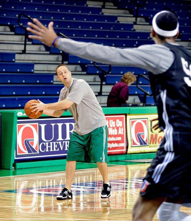Red Claws Coach Austin Ainge works with players during a practice Tuesday. Ainge and the team's management must trim the roster from 13 to 10 players.