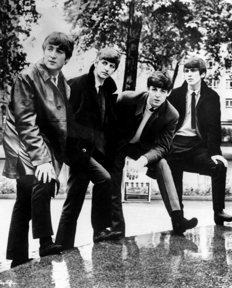 "The Beatles – from left, John Lennon, Ringo Starr, Paul McCartney and George Harrison – pose for a photograph. Apple Inc.'s iTunes store will sell 13 remastered Beatles studio albums, the two-volume ""Past Masters"" set and the classic ""Red"" and ""Blue"" collections."