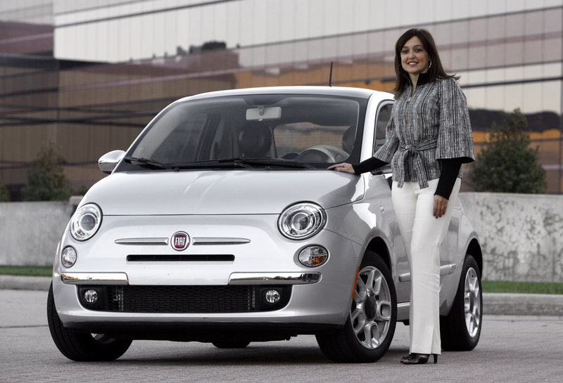 Laura J. Soave, head of the Fiat Brand for North America, stands next to a 2011 Fiat 500.