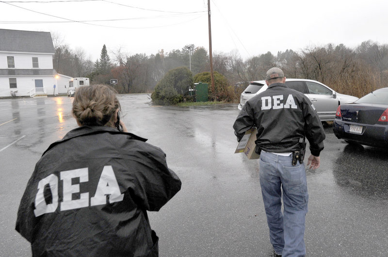 DEA agents leave the offices of Dr. John Perry at Atlantic Foot & Ankle Center at 1711 Congress St. in Portland Wednesday morning carrying small boxes.