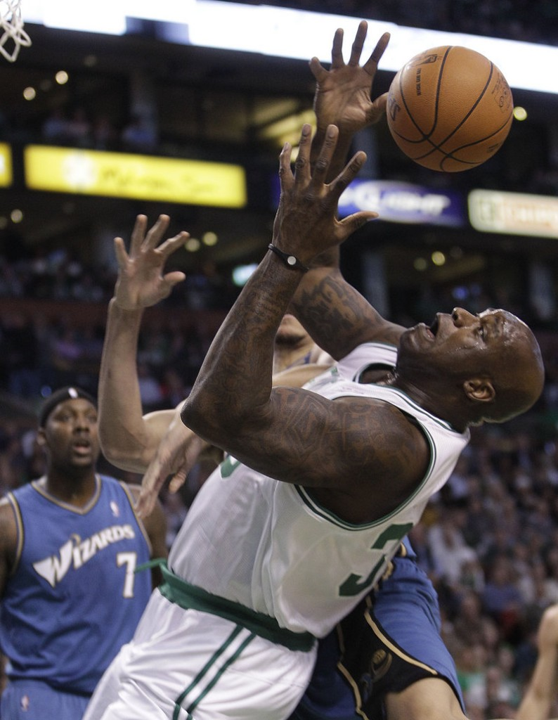 Shaquille O'Neal of the Celtics loses control of an offensive rebound in front of Washington's Andray Blatche Wednesday night. O'Neal had 13 points in Boston's 114-83 win.