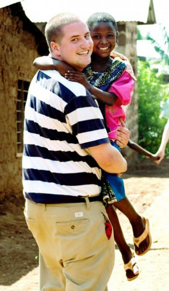 Seth Diemond poses with Elizabeth, a young girl he befriended in 2008 while volunteering in Tanzania. Thanks to his financial support, Elizabeth is now enrolled in a private boarding school.