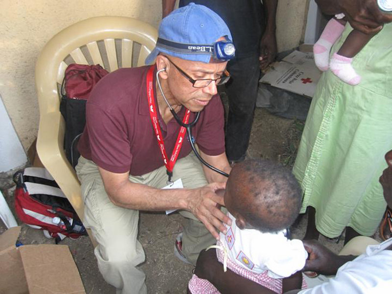 Dr. Hector Tarraza checks a young child while caring for earthquake victims in Port-au-Prince, Haiti, earlier this year. The Portland-based physician spends at least five weeks each year in poor communities from Haiti to Peru to Sierra Leone.