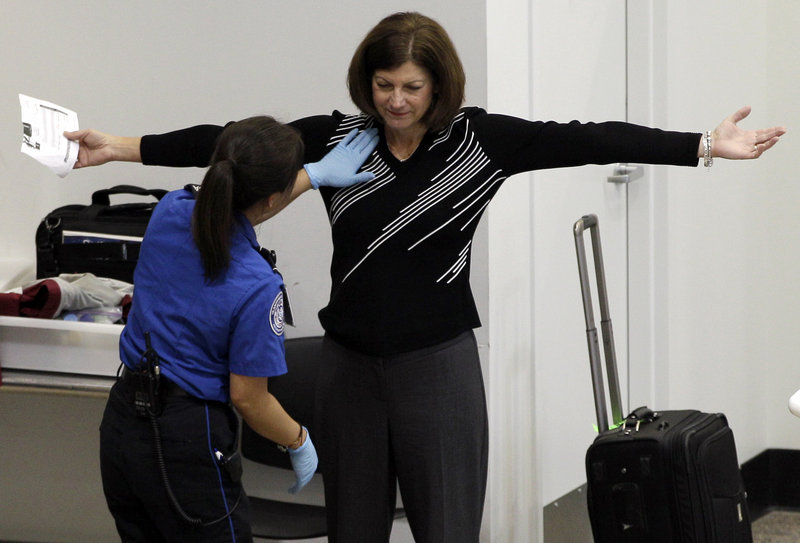 A passenger undergoes a pat-down search during security screening last week at Seattle-Tacoma International Airport in Seattle.