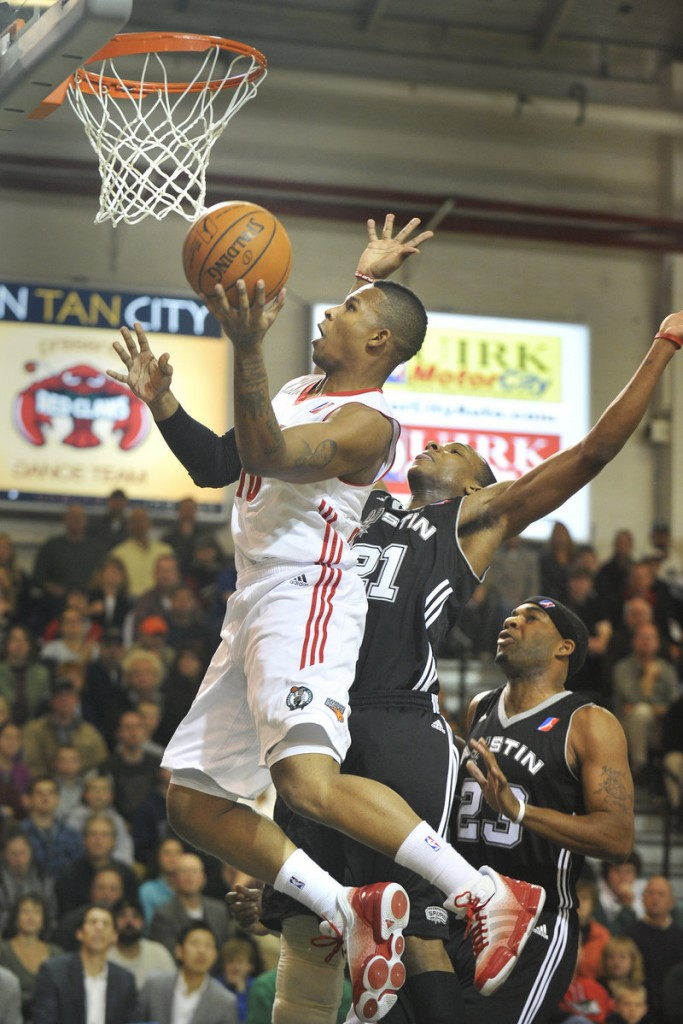 Lawrence Westbrook of the Maine Red Claws drives to the basket around Dominique Archie of the Austin Toros during Austin's 103-97 victory Friday night in a D-League opener at the Portland Expo. The teams will meet again tonight at the Expo.