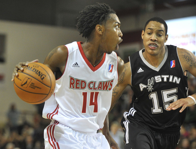 Jamar Smith of the Maine Red Claws looks for an opening Friday night while guarded by Kevin Palmer of the Austin Toros during Austin's 103-97 victory in this season's opener at the Portland Expo. Maine has seven rookies on its 10-player roster.