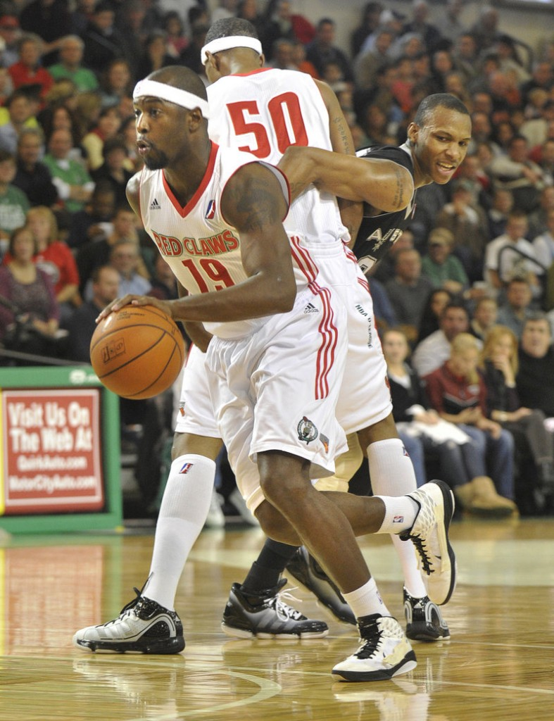 Mario West of the Maine Red Claws uses a screen set by Magnum Rolle to lose his defender and drive to the basket.