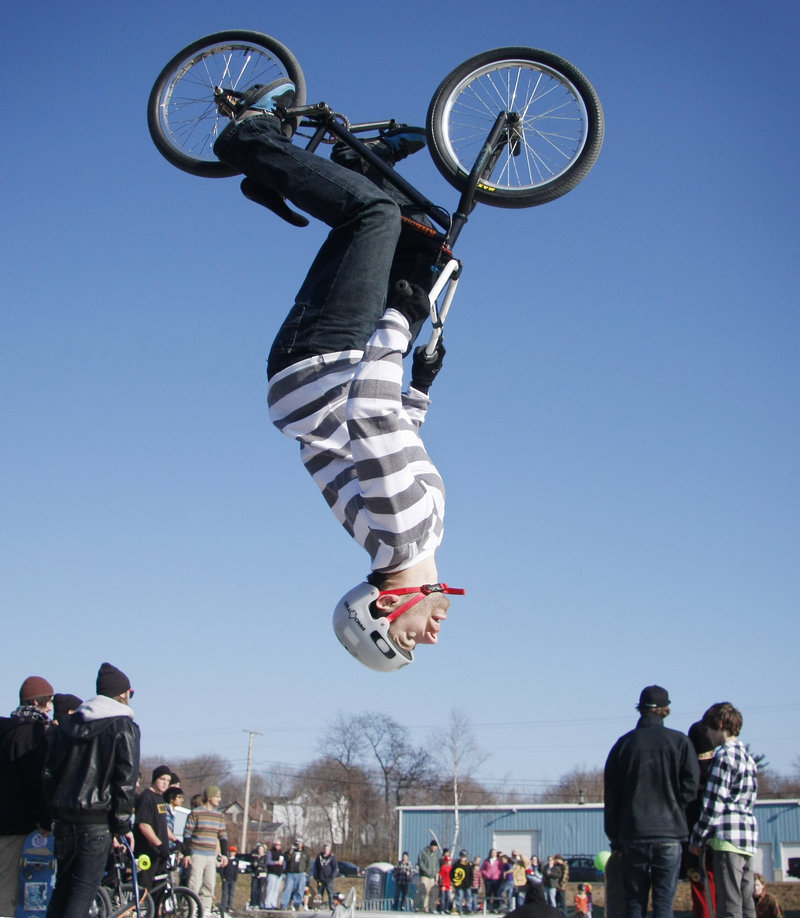 Andy MacKellar of Topsham does a back flip at the new skatepark in Portland on Saturday. City funding and private donations underwrote the $250,000 facility.