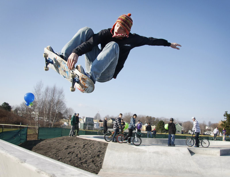 Chris Peterson of Winthrop flies at the opening of the new skatepark at Dougherty Field on St. James Street in Portland on Saturday.