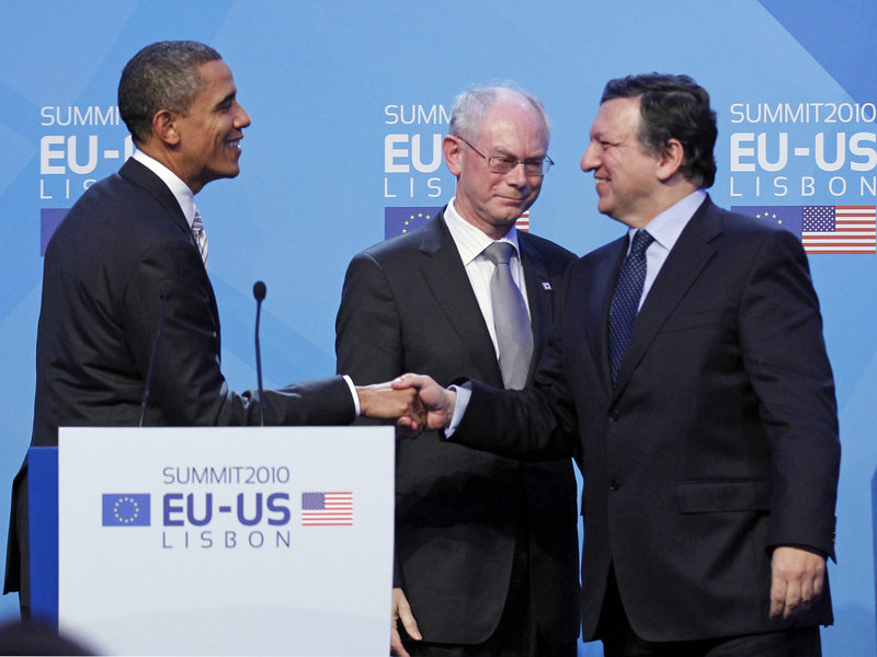 President Obama shakes hands with European Commission President Jose Manuel Barroso, right, and European Council President Herman Van Rompuy after their joint statement at the end of the EU Summit in Lisbon, Portugal, on Saturday.