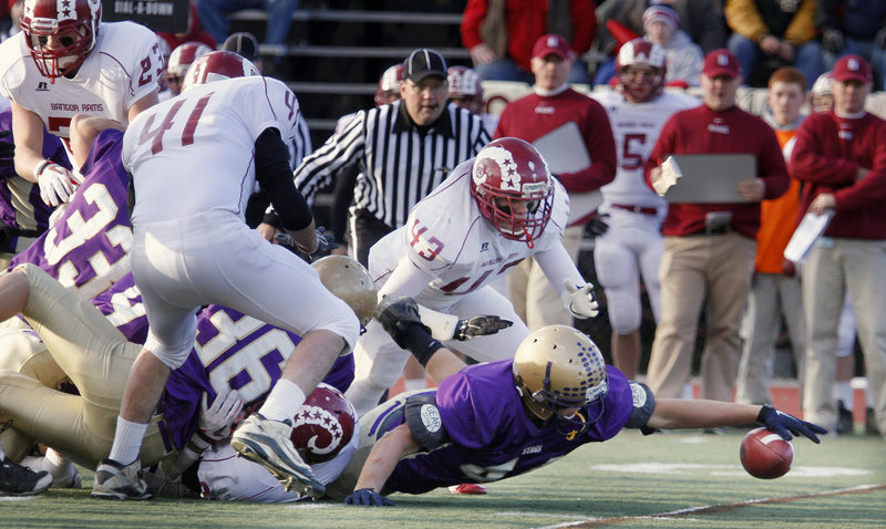 Andrew Bennett of Cheverus reaches to try and haul in a Bangor fumble in the first quarter of Cheverus 46-8 victory in the Class A championship game Saturday at Fitzpatrick Stadium.