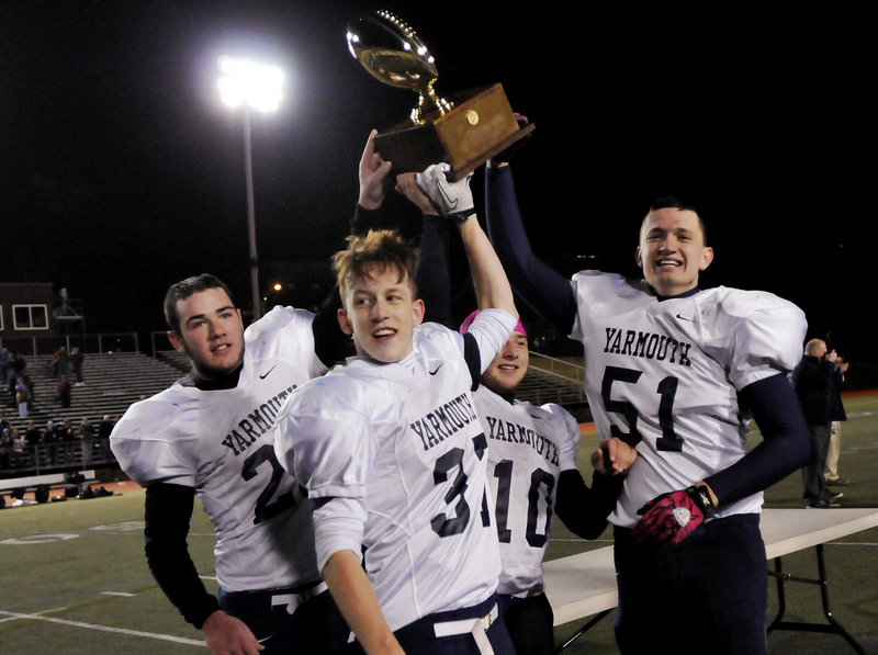 Yarmouth raised a football Gold Ball for the first time. Doing the honors were, left to right, captains Nick Proscia, Asa Arden, Nate Pingitore and Jack Watterson.