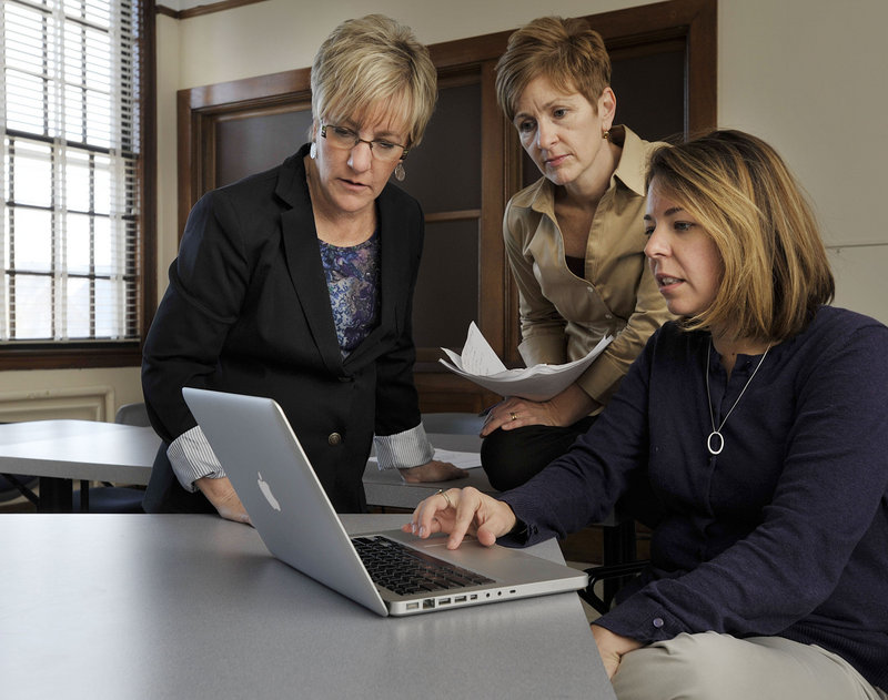 From left, professors Mary Madden, Elizabeth Allan and grad student Laurie Sidelko review their work at UMaine in Orono.
