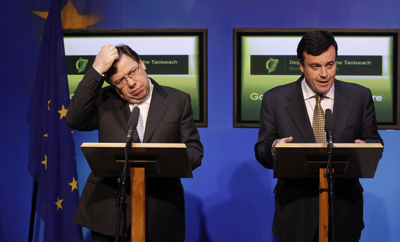 Irish Prime Minister Brian Cowen, left, and Finance Minister Brian Lenihan speak to the media in Dublin on Sunday. The debt-struck country Sunday formally appealed for a massive EU-IMF loan to stem the flight of capital from its banks.