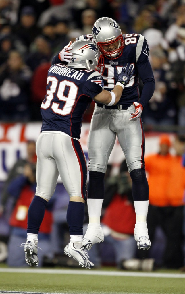 Aaron Hernandez, right, celebrates his second-quarter touchdown reception with Danny Woodhead on Sunday. It was Hernandez's third touchdown catch of the year.