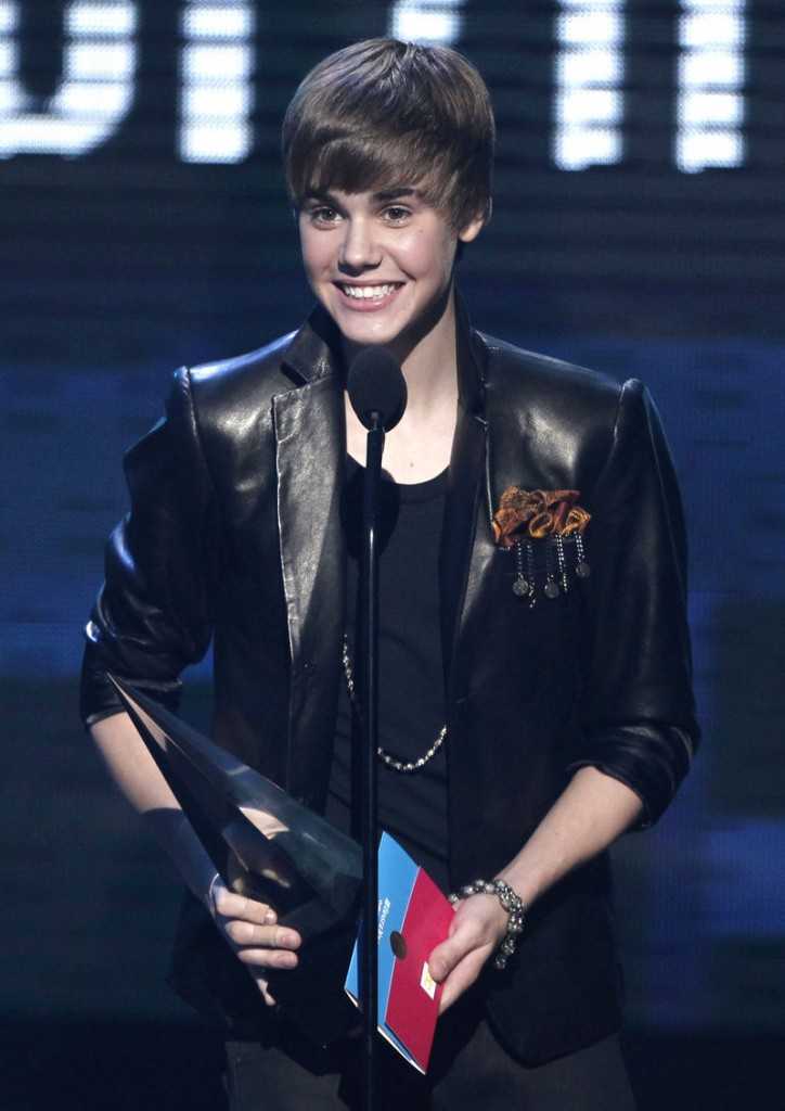 Justin Bieber accepts the award for pop-rock favorite male artist at the American Music Awards on Sunday.