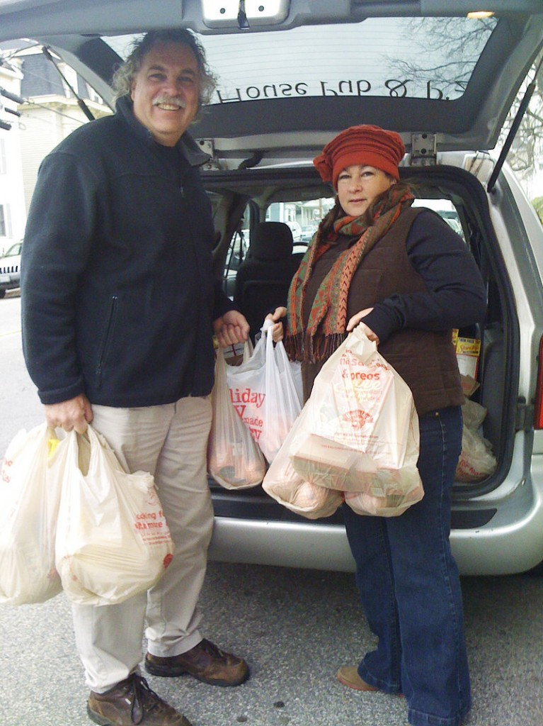 "Jack and Vassie Fowler unload turkeys from their minivan Monday morning at the Stone Soup Food Pantry in Biddeford. ""They have been our biggest help,"" says Kathy Duke, director of the pantry."