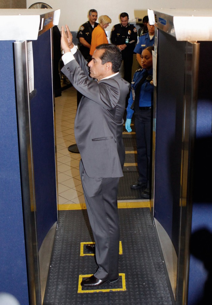 Los Angeles Mayor Antonio Villaraigosa stands inside a body scanner Monday at Los Angeles International airport. He urged Thanksgiving travelers to cooperate with security officials.