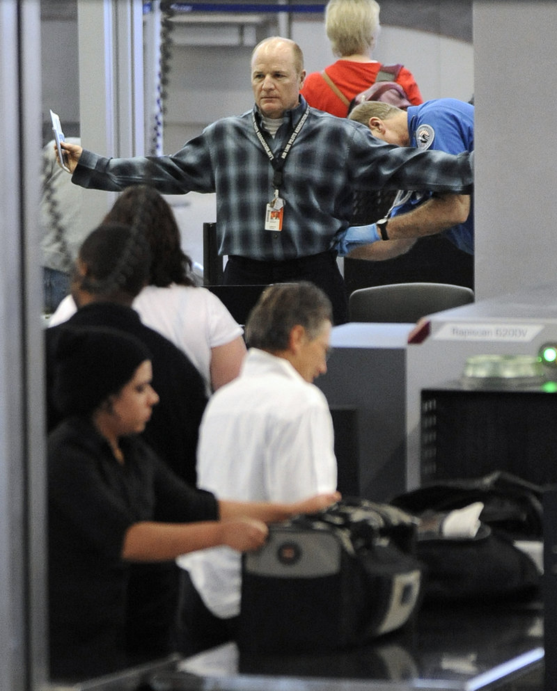The Associated Press This is a two-line cutline that An traveller is patted down by a TSA agent at O'Hare International Airport in Chicago, Monday, Nov. 22, 2010. There are new requirements at some U.S. airports that air passengers must pass through full-body scanners that produce a virtually naked image. Those who refuse to go through the scanners are subject to thorough pat-downs. (AP Photo/Paul Beaty)
