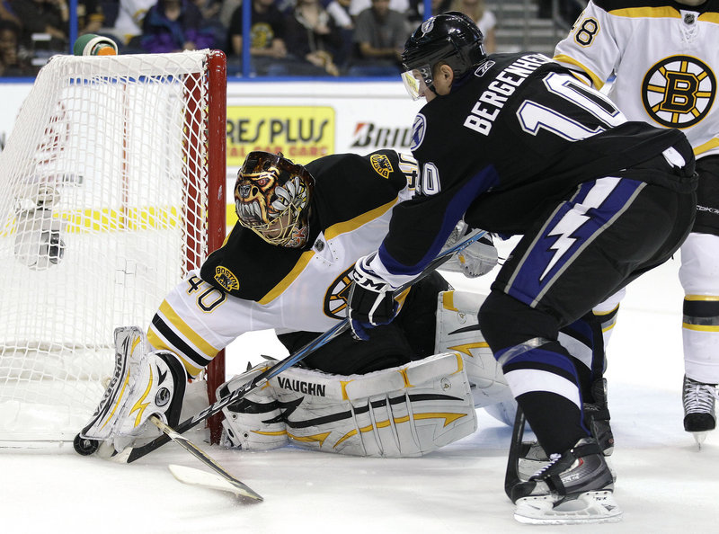 Sean Bergenheim of the Lightning tries to poke the puck away from Bruins goalie Tuukka Rask during Monday's game at Tampa, Fla. Rask made 33 saves in a 3-1 loss.