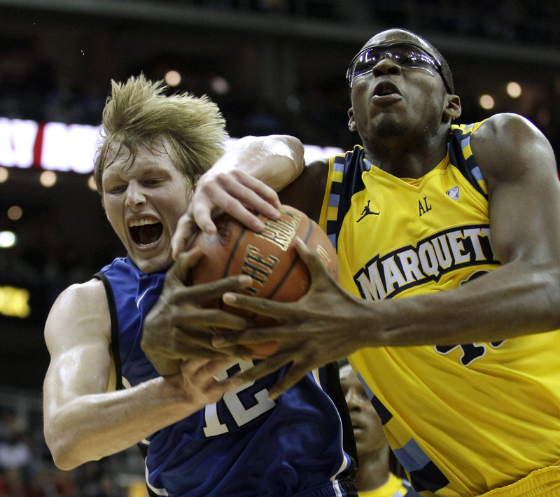 Duke's Kyle Singler, left, and Marquette's Chris Otule fight for a rebound during their CBE Classic semifinal Monday night in Kansas City, Mo. Top-ranked Duke won, 82-77.