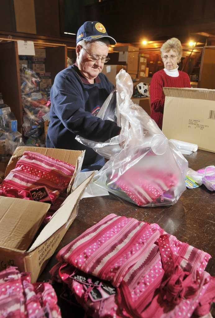 Walter and Nina Braley, of Standish, long-time volunteers for the Bruce Roberts Toy Fund, prepare gift bags targeted for a young girls. The fund, which serves thousands of needy children in southern and coastal Maine is in its 62nd year.