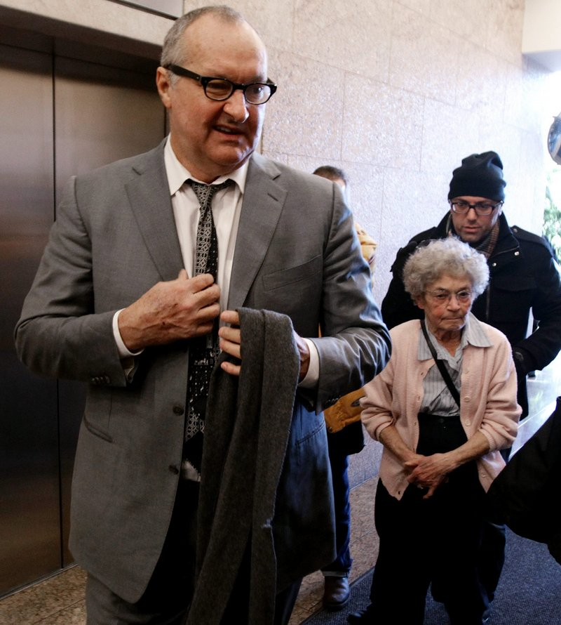 """Actor Randy Quaid arrives for a Canadian immigration and refugee board hearing in Vancouver on Tuesday. He claims """"Hollywood star whackers"""" are out to get him."""