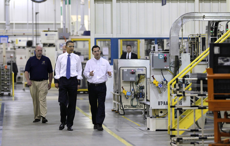 President Obama, with Vice President Biden behind him, tour Chrysler's Indiana Transmission Plant II in Kokomo on Tuesday. At right is plant manager Jeremy Keating, at left is Richie Boruff, president of United Auto Workers Local 685.
