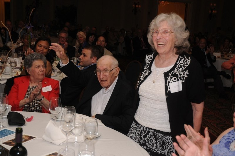 Rose Novick, standing, and Jack Novick are applauded last June during a Jewish Community Alliance fundraising dinner.