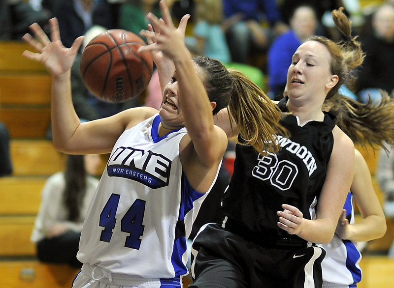 Beth Suggs of the University of New England, left, attempts to control a rebound Tuesday night after gaining inside position on Colleen Sweeney of Bowdoin during Bowdoin's 82-55 victory. It was UNE's first setback after four wins.