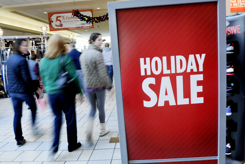 Shoppers browse at the Maine Mall on Wednesday. Many merchants say they expect a strong holiday shopping season.