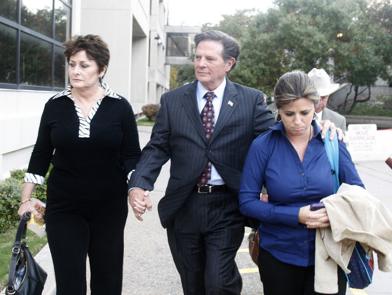 Former House Majority Leader Tom Delay, his wife, Christine, left, and daughter Danielle leave the Travis County Courthouse in Austin, Texas, on Wednesday. He remains free on bond and his sentencing is set to begin Dec. 20.