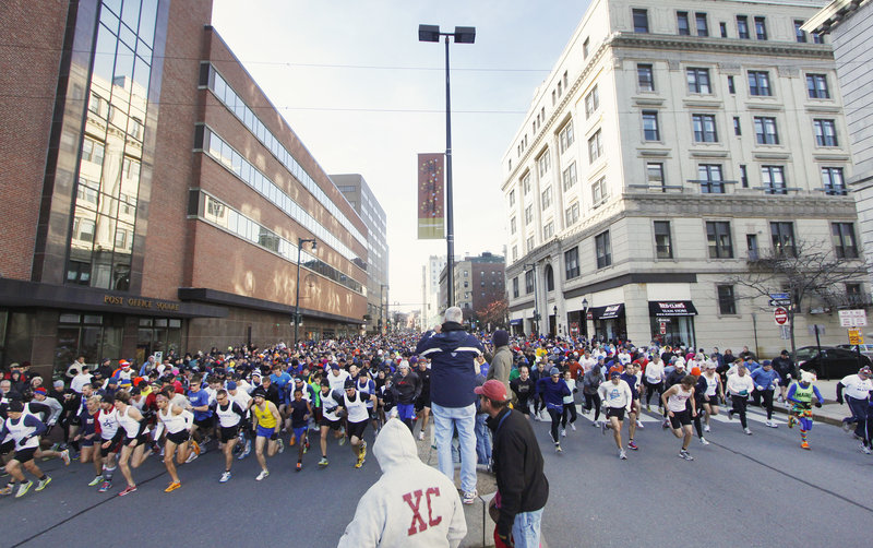 And off they go Thursday, the record field of 1,649 runners that participated in the annual Thanksgiving Day 4-miler, right near City Hall on Congress Street in downtown Portland.