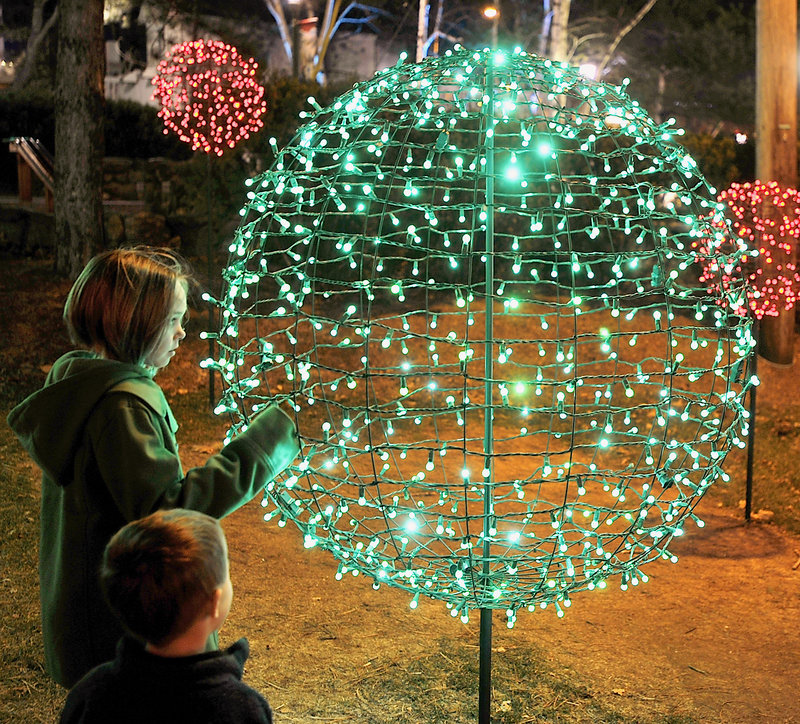 Natalie Wright, 9, of Woolwich and her cousin, Sawyer, 3, who is visiting from Colorado, are fascinated by light forms on the L.L Bean campus in Freeport.