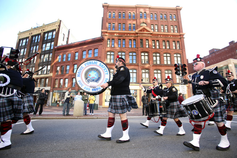 """Members of the Maine Public Safety Pipe and Drum Corps play during the Veterans Day Parade in Portland. """"When you start feeling it, it really flows,"""" says teen bagpiper Colin Arnold."""
