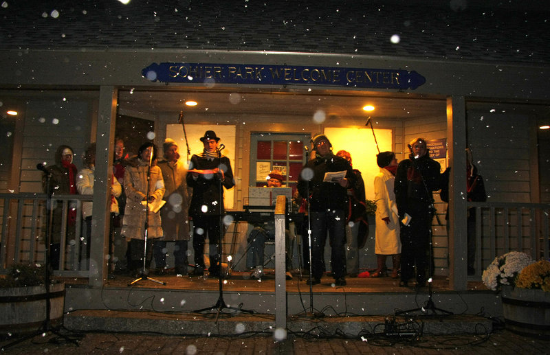 The Coastal Capers perform holiday melodies as snow falls Saturday afternoon.