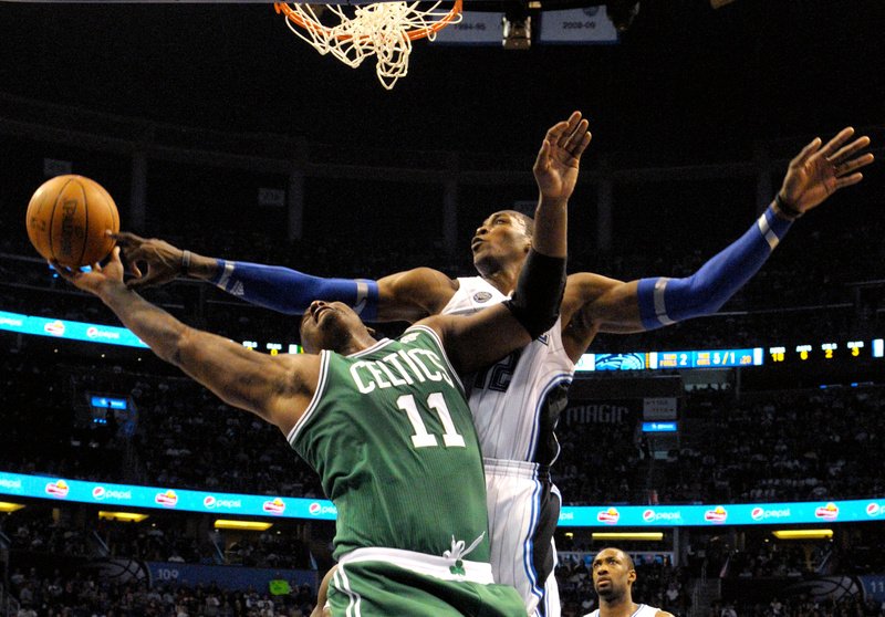 Dwight Howard of the Magic blocks a shot by Boston's Glen Davis in Saturday's game at Orlando, Fla. The Magic won 86-78 to break Boston's 14-game winning streak.