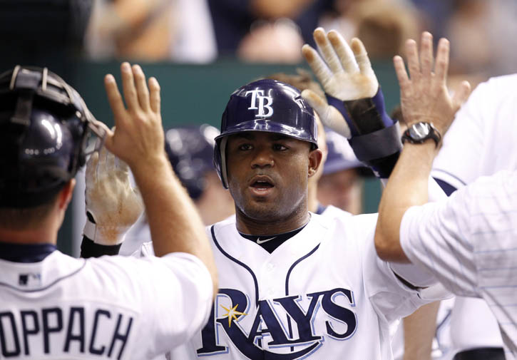 A July 27, 2010, photo of Carl Crawford being congratulated after scoring in the sixth inning of the Rays' 3-2 victory over the Detroit Tigers.