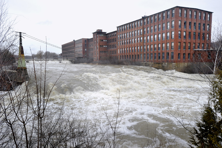 High water on the Presumpscot River flows over Westbrook's Saccarappa Falls following last night's heavy rains.