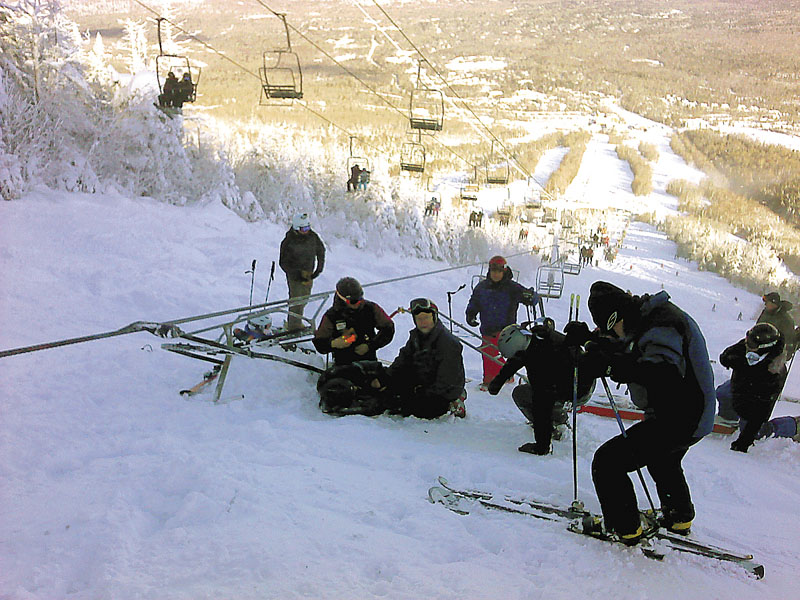 Skiers await rescue after the Spillway East chairlift derailed, sending riders 30 feet down to the snow below.
