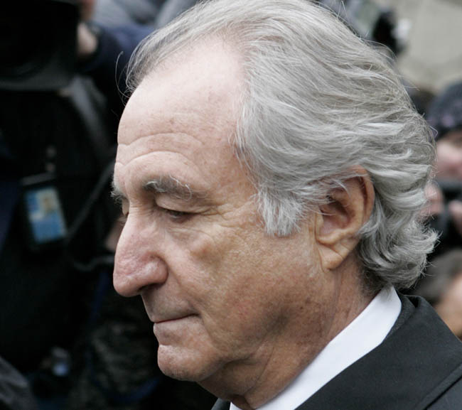 Massachusetts businessman and philanthropist Carl Shapiro was an early investor in the investment business of Bernard Madoff, who is shown here in a March 2009 photo.