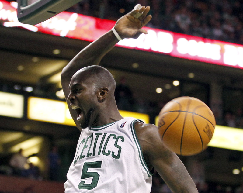 Kevin Garnett of the Celtics yells after dunking the ball against the Indiana Pacers during the first half Sunday in Boston. The Celtics won 99-91.