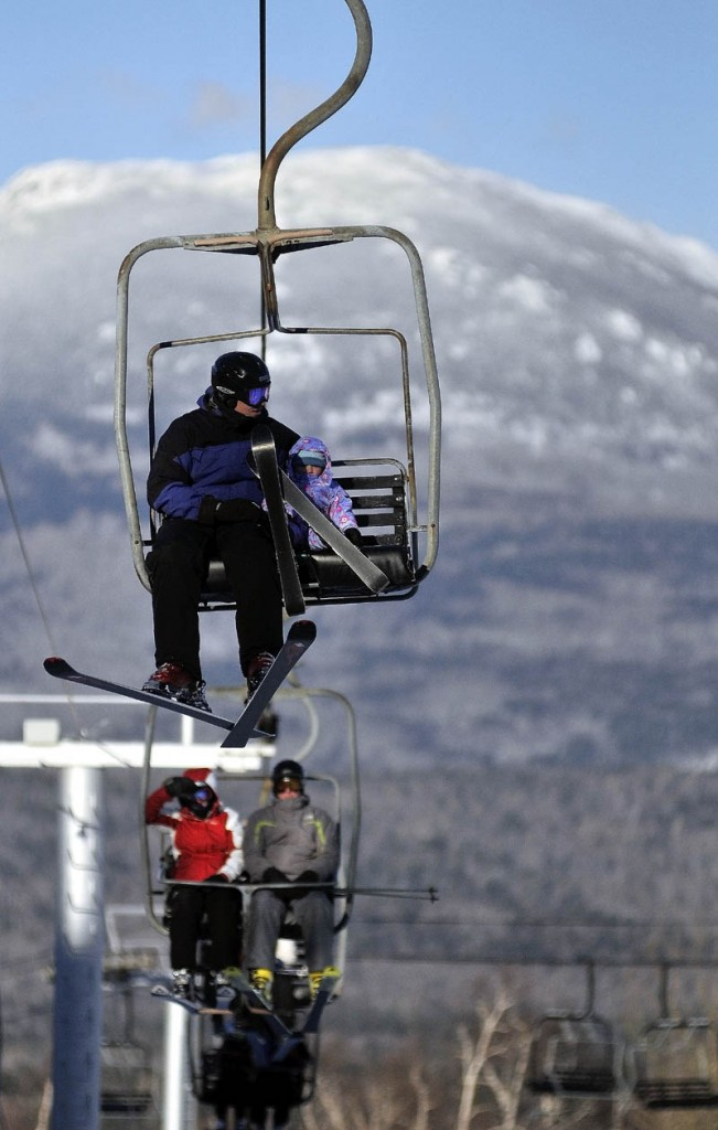 Skiers ride a chairlift Tuesday afternoon at Sugarloaf. A lift derailed in high winds at Maine's tallest ski mountain Tuesday, sending skiers plummeting as far as 30 feet to the slope below and injuring several people.