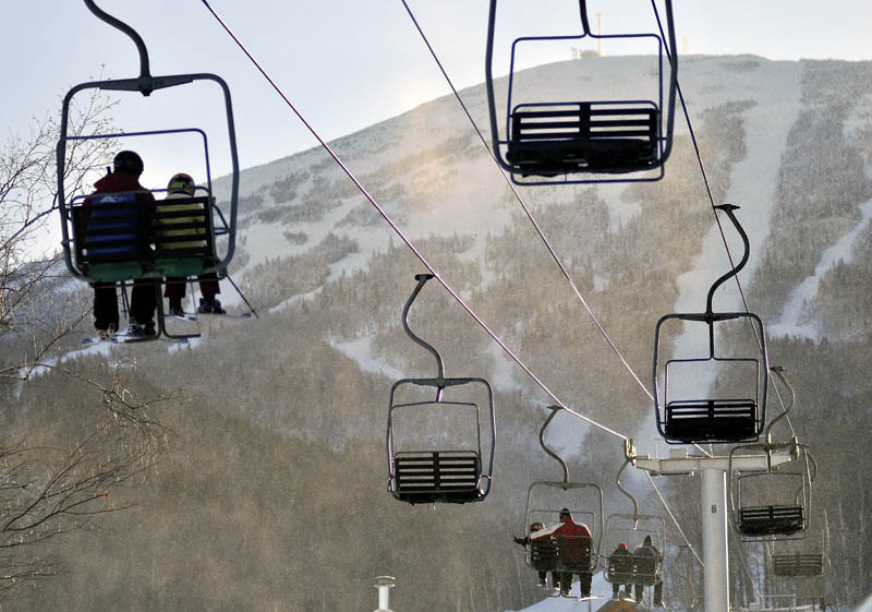 Skiers ride a chair-lift at Sugarloaf after a chair lift derailed in high winds earlier in the day. The derailment at Maine's tallest ski mountain Tuesday, sent skiers plummeting as far as 30 feet to the slope below and injuring several people.